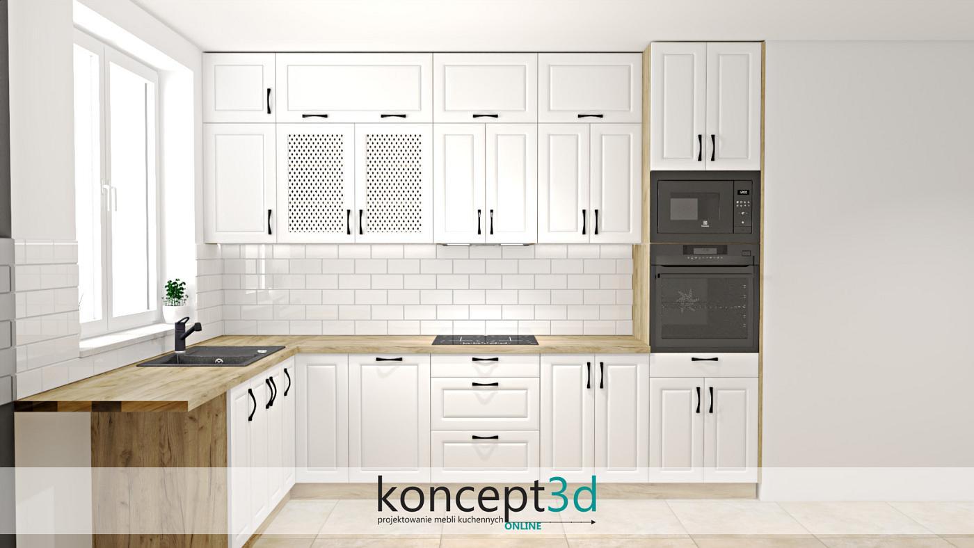 Dąb Craft Złoty K003 to nie tylko nowoczesne kuchnie o gładkich frontach. Bardzo często spotkamy ten drewniany dekor w aranżacjach klasycznych, gdzie motywem przewodnim będą żłobione drzwi lub klasyczne dekoracje. Na przykładowej aranżacji w oczy rzucą się nam czarne uchwyty oraz coraz częściej występująca cegiełka ceramiczna na ścianie