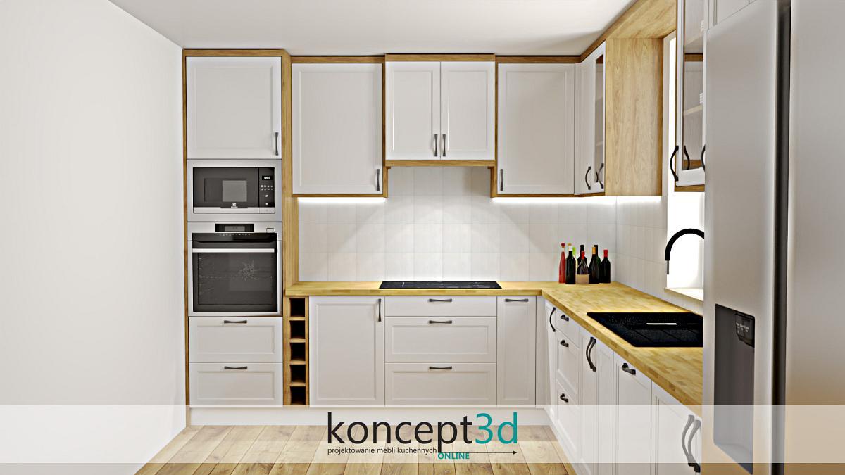 Dębowy blat w białej kuchni w formie klepki. Całość zestawiona z czarnymi uchwytami i białymi frontami
